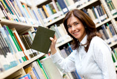 Librarian placing a book Royalty Free Stock Photo