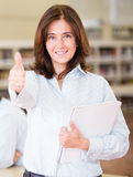 Librarian with thumbs up Royalty Free Stock Photo