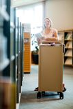 Librarian With Trolley Of Books In Library Royalty Free Stock Photo