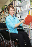 Librarian in Wheelchair Royalty Free Stock Photos