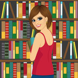 Librarian woman in library holding books Stock Images
