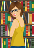 Librarian woman in library holding books Royalty Free Stock Images