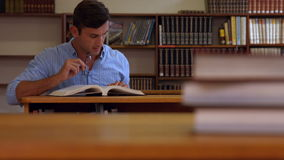 Librarian at work in the library stock video footage