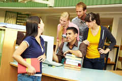 Librarians helping student Royalty Free Stock Photography