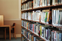 Library. Stack of library books and cubicle for reading royalty free stock photos