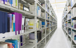 Library. The aisles in a public library with shelves full of books Royalty Free Stock Images