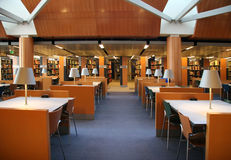 Library. Tables and chairs in an empty library stock images