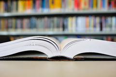 Library. Closeup open book in library on the table Royalty Free Stock Photos