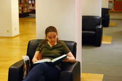 Library. Young student in the library royalty free stock photography