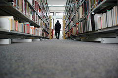 Library Aisle with Books and man Stock Photo