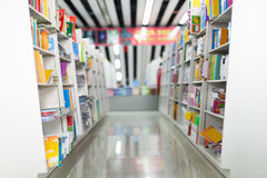 Library. The aisles in a public library with shelves full of books Stock Photo