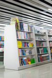 Library. The aisles in a public library with shelves full of books Royalty Free Stock Image