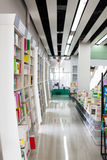 Library. The aisles in a public library with shelves full of books Stock Photography