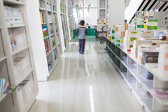 Library. The aisles in a public library with shelves full of books Royalty Free Stock Photos