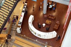 Geometric furniture placement adds interest. The library in Austin, Texas opened in October 2017. The light filled spaces make visits to the library much stock photo