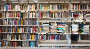 Library book shelves. Assorted library books on shelves, titles are blurred Stock Photography