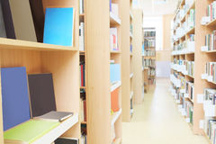 Library with book shelves Royalty Free Stock Photo