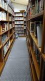 Library book shelves. Wooden book shelves in library Royalty Free Stock Photos