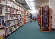 Library books on long shelves. Royalty Free Stock Photography