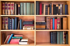 Library books. Vintage library interior with old books on the shelves Royalty Free Stock Photo