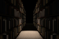 Library Bookshelf Aisle. A direct top view of a row of a library bookshelf in a carpeted aisle dramatically lit by a single spotlight stock image