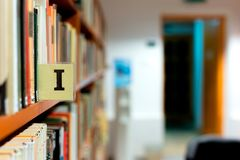 Library bookshelf closeup with letter Royalty Free Stock Photo