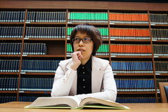 Library, bookshelf,reading, thinking  Royalty Free Stock Image