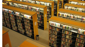 Library bookshelves Stock Image