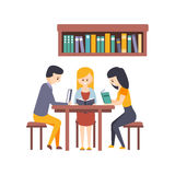 Library Or Bookstore With Students Reading Books And Studying Together At The Desk Royalty Free Stock Photography