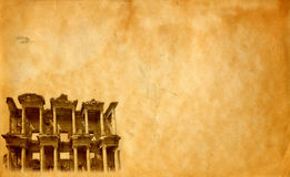 Library of Celsus at Ephesus background. Archaeological background. Old paper and image of Library of Celsus in Ephesus, Turkey royalty free stock photography