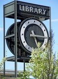 Library Clock Tower. Against the sky and trees stock photo