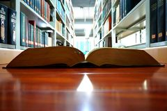 Library, college, univeristy, and opened books. In the image, it is a library of a Chinese university royalty free stock photo