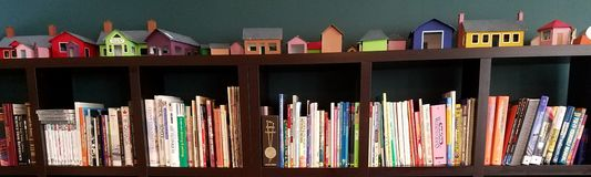 Books on a Shelf with Model Houses royalty free stock images