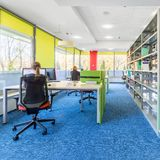 Colorful library with computer workstation. Colorful and new design library interior with computer workstation and modern shelving