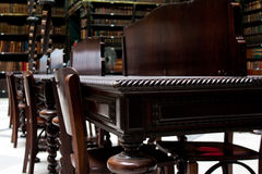 Library Desk. Desks and chairs in an old library Stock Photography
