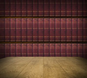 Library. Empty tabletop and bookshelf with old hardcovered books in the background Royalty Free Stock Photography