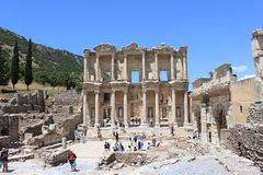 Library at Ephesus. Tourists wander around the re-constructed ruins of the library at Ephesus in Turkey Stock Image