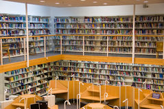 Library interior. Modern library interior, a lot of books on the bookshelfs stock images