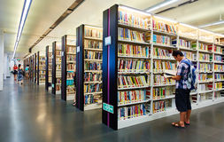 Library. Interior of Guangzhou public library, China. Readers, books and bookshelf in library Royalty Free Stock Photo