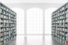 Library interior. Design with massive bookshelves and concrete floor. 3D Rendering Stock Photo