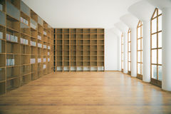Library interior with empty shelves. Library interior with empty wooden shelves, floor, concrete walls, ceiling, columns and windows with city view. 3D Rendering Stock Photos
