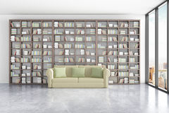 Library interior with massive bookshelves, comfortable green couch and window with city view. Royalty Free Stock Photos