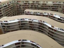 Library. Interior of modern library with shelves of books stock image