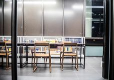 Bangkok - June 5,library interior,library setting with books,table ,many chair and reading material on white shelf at TCDC Library. Library interior,library royalty free stock image