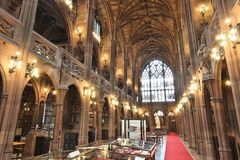Library in Manchester. MANCHESTER, UK - APRIL 22, 2013: Interior view of John Rylands Library in Manchester, UK. The library opened to public in 1900 and is a stock photos