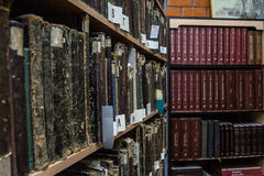Library. Old books on the shelves in library Stock Photography