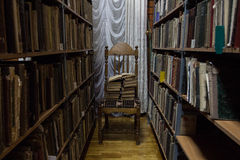 Library. Old books on the shelves in library Royalty Free Stock Photography