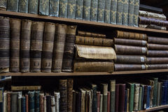 Library. Old books on the shelves in library Stock Photos