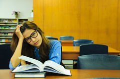 Library. Portrait of asia student with open book reading it in university library Stock Photography