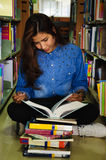 Library. Portrait of asia student with open book reading it in university library Stock Photo
